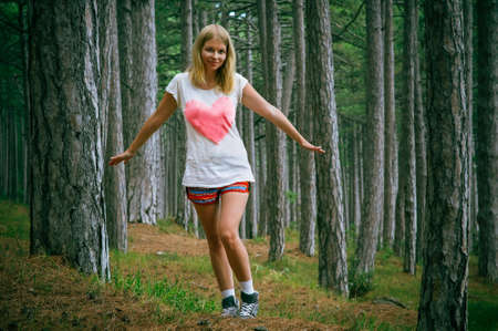 Young Woman walking in Coniferous deep Forest beautiful green summer landscape outdoor lifestyle photo