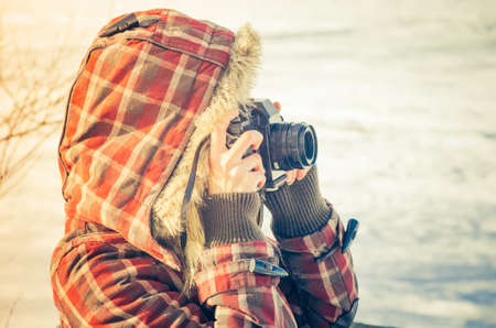 instant camera: Woman photographer with retro photo camera outdoor Lifestyle concept  winter nature on background