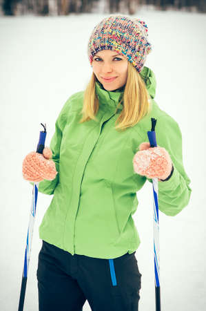 Young Woman with ski happy smiling face winter time snow\ Skiing Sport and healthy Lifestyle concept