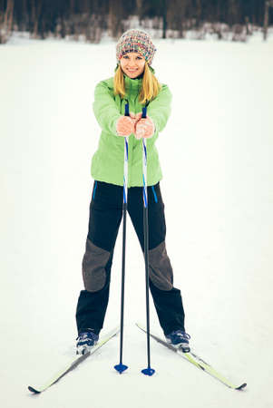 ski walking: Young Woman with ski happy smiling face winter time snow Skiing Sport and healthy Lifestyle concept
