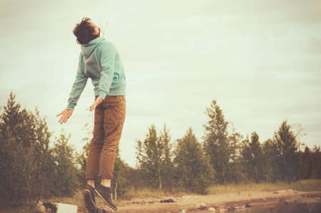 Young Man Flying levitation jumping outdoor relax Lifestyle happiness spiritual concept retro film colors trendy style
