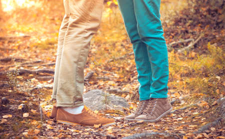 Couple Man and Woman Feet in Love Romantic Outdoor with Autumn season nature on background Fashion trendy style photo