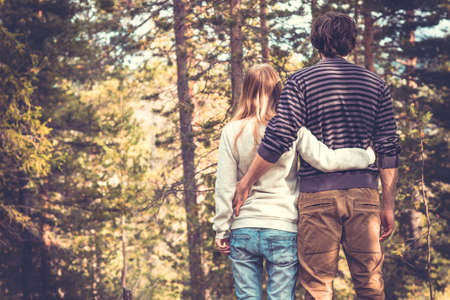 lover: Young Couple Man and Woman Hugging in Love Romantic Outdoor with forest nature on background Fashion trendy style Stock Photo
