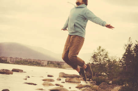 young boy feet: Young Man Flying levitation jumping outdoor relax Lifestyle Travel happiness spiritual concept retro film colors