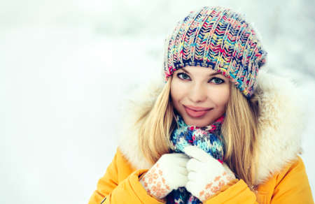 Winter Woman Face happy smiling in knitting hat fashion clothing outdoor Travel Lifestyle snow nature on background Imagens