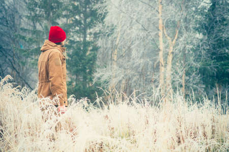 melancholy: Young Man walking alone outdoor with foggy scandinavian forest nature on background Travel Lifestyle and melancholy emotions concept film effects colors