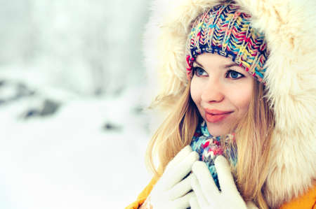 fur hood: Winter Woman Face in hat and fur hood fashion outdoor Lifestyle vacations snow nature on background