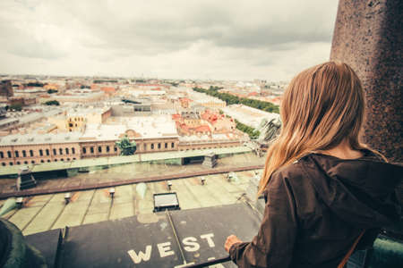 aerial view city: Young Woman relaxing outdoor with aerial view city on background Lifestyle Travel concept Stock Photo