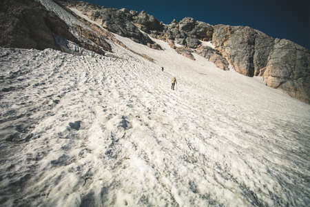snow climbing: Rocky Mountains Glacier snow with travelers climbing Landscape blue sky Summer Travel scenic aerial view