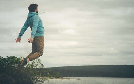 levitation: Young Man Flying levitation jumping outdoor relax Lifestyle Travel happiness spiritual concept moody colors