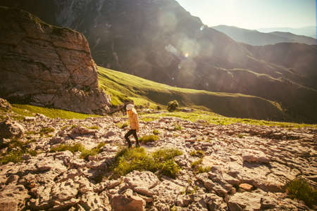 Young Woman Traveler With Trekking Poles Relaxing Outdoor ...