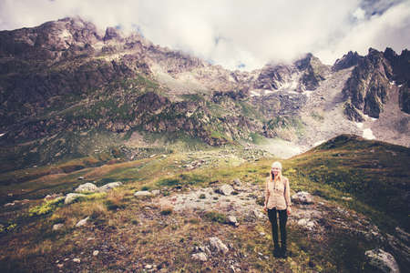Woman Traveler mountaineering Travel Lifestyle concept Summer vacations outdoor rocky mountains on background moody weather Standard-Bild