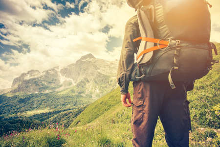 Traveler Man with backpack mountaineering Travel Lifestyle concept mountains on background Summer trip vacations outdoor 版權商用圖片 - 58406813