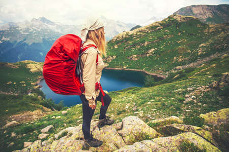 Young Woman with red backpack mountaineering Travel Lifestyle concept lake and mountains landscape on background vacations adventure journey outdoor Imagens - 58406842