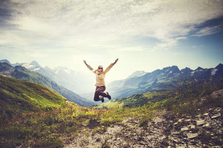 Young Woman jumping up Flying levitation with mountains landscape on background Lifestyle Travel happy emotions concept outdoor