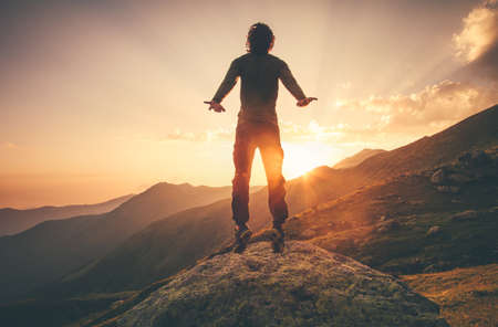 levitation: Young Man Flying levitation jumping in sunset mountains Lifestyle Travel concept outdoor
