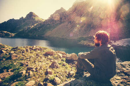 alone boy: Traveler Man relaxing alone Travel Lifestyle concept lake and mountains sunny landscape on background outdoor