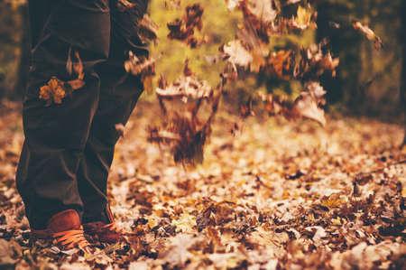 Feet Man walking Outdoor with fall leaves Autumn season nature on background Lifestyle Fashion trendy style Stock Photo