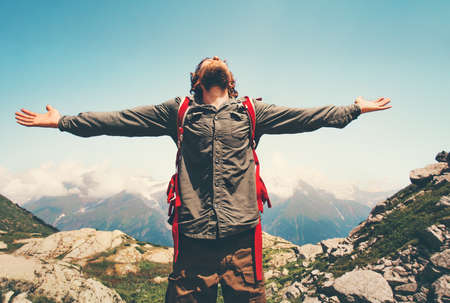 Happy Man Traveler hands raised outdoor Travel Lifestyle concept mountains landscape on background adventure vacations