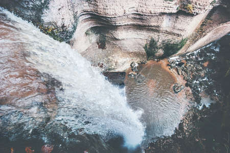 serene landscape: Waterfall Landscape aerial view at rocky canyon Travel serene scenery