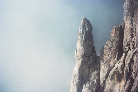 chillout: Foggy rocky Mountains cliff Landscape minimalistic style Travel serene scenic aerial view moody weather