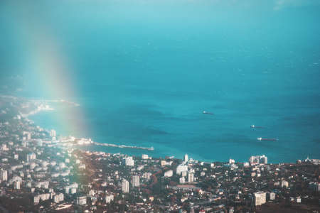 Aerial view of turquoise Sea and port city with rainbow beautiful Landscape