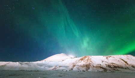 polaris: Northern lights Aurora borealis above Mountains Landscape Winter Travel scandinavian night scenery natural colors Stock Photo