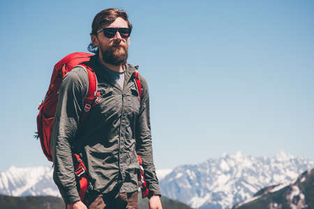 Man Traveler hiking in mountains Travel Lifestyle success concept adventure active vacations outdoor