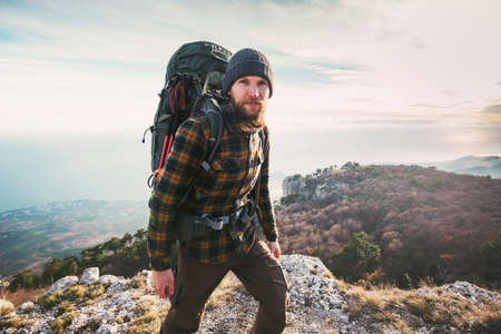 Bearded Man backpacker hiking in mountains Travel Lifestyle concept adventure active vacations outdoor mountaineering sport Banque d'images