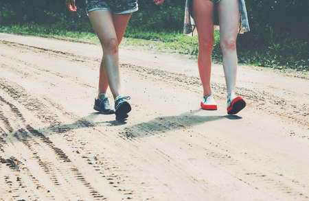 Feet girls walking on the road Lifestyle Travel and friendship concept summer vacations Stockfoto