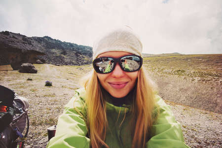 Woman traveler taking selfie in mountains Travel Lifestyle adventure concept active vacations outdoor mountaineering hiking sport success and healthy life Stockfoto