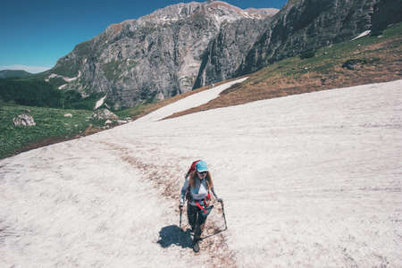 Girl hiker climbing on mountains glacier with backpack Travel Lifestyle concept adventure active summer vacations outdoor into the wild Banque d'images
