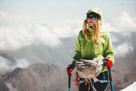 Woman climbing on mountain summit Travel Lifestyle adventure concept active vacations outdoor mountaineering sport success happiness emotions Stockfoto