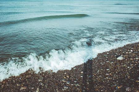 Overzeese golven zomer Landschap en man schaduw