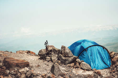 Tent camping in Mountains Landscape Travel Lifestyle concept Summer adventure vacations outdoor Stockfoto