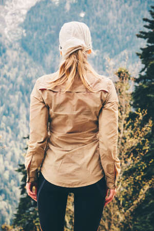 Traveler Woman enjoying forest mountains Travel Lifestyle concept adventure summer vacations outdoor hiking alone into the wild