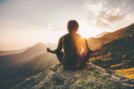 Man meditating yoga at sunset mountains Travel Lifestyle relaxation emotional concept adventure summer vacations outdoor harmony with nature 版權商用圖片 - 78522912
