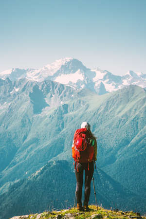 Woman Traveler standing at mountains nature landscape with backpack Travel Lifestyle concept adventure summer vacations outdoor