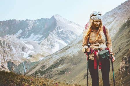 Woman hiking at rocky mountains Travel Lifestyle wanderlust concept summer vacations outdoor