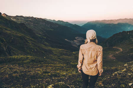 Woman hiking at sunset mountains Travel Lifestyle wanderlust concept summer vacations outdoor