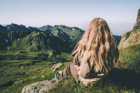 Blonde Woman relaxing on mountains summit Travel Lifestyle wanderlust concept summer vacations outdoor Stockfoto