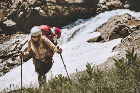 Woman traveler hiking at mountains Travel Lifestyle wanderlust adventure concept summer vacations outdoor wild nature