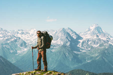 Hiker Man enjoying mountains view with backpack Travel Lifestyle concept adventure vacations outdoor