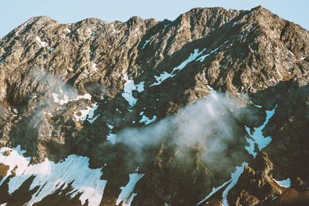 Rocky Mountains and clouds Landscape aerial view Summer Travel wild nature beautiful scenery