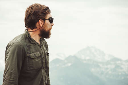Bearded Man enjoying mountains view Travel Lifestyle concept adventure vacations outdoor