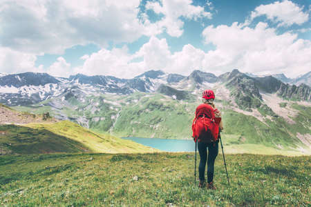 Woman wander lake in mountains Travel Lifestyle adventure concept summer vacations outdoor exploring wild nature