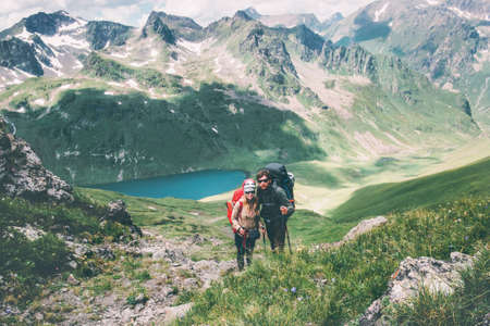 Couple travelers Man and Woman climbing in mountains Love and Travel happy emotions Lifestyle concept. Young family traveling active adventure vacations