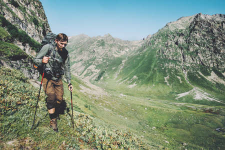Man hiking trail at mountains with backpack landscape Travel Lifestyle wanderlust adventure concept summer vacations outdoor Stockfoto