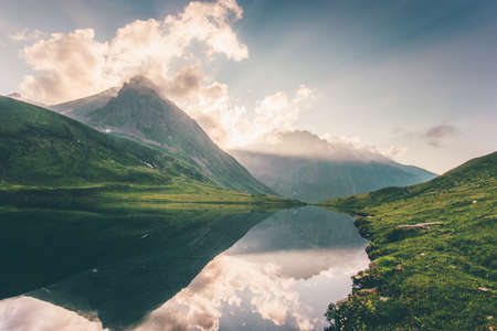 Sunset Landscape Mountains and Lake reflection with sky clouds Summer Travel serene view