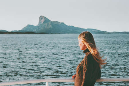 Blonde Woman Traveler on sea ferry in Norway landscape Travel Lifestyle concept adventure vacations outdoor